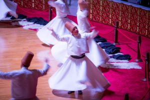 A whirling dervish dances