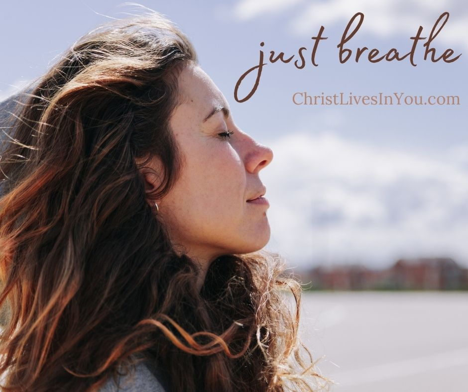 Woman with eyes closed, meditates and breathes.
